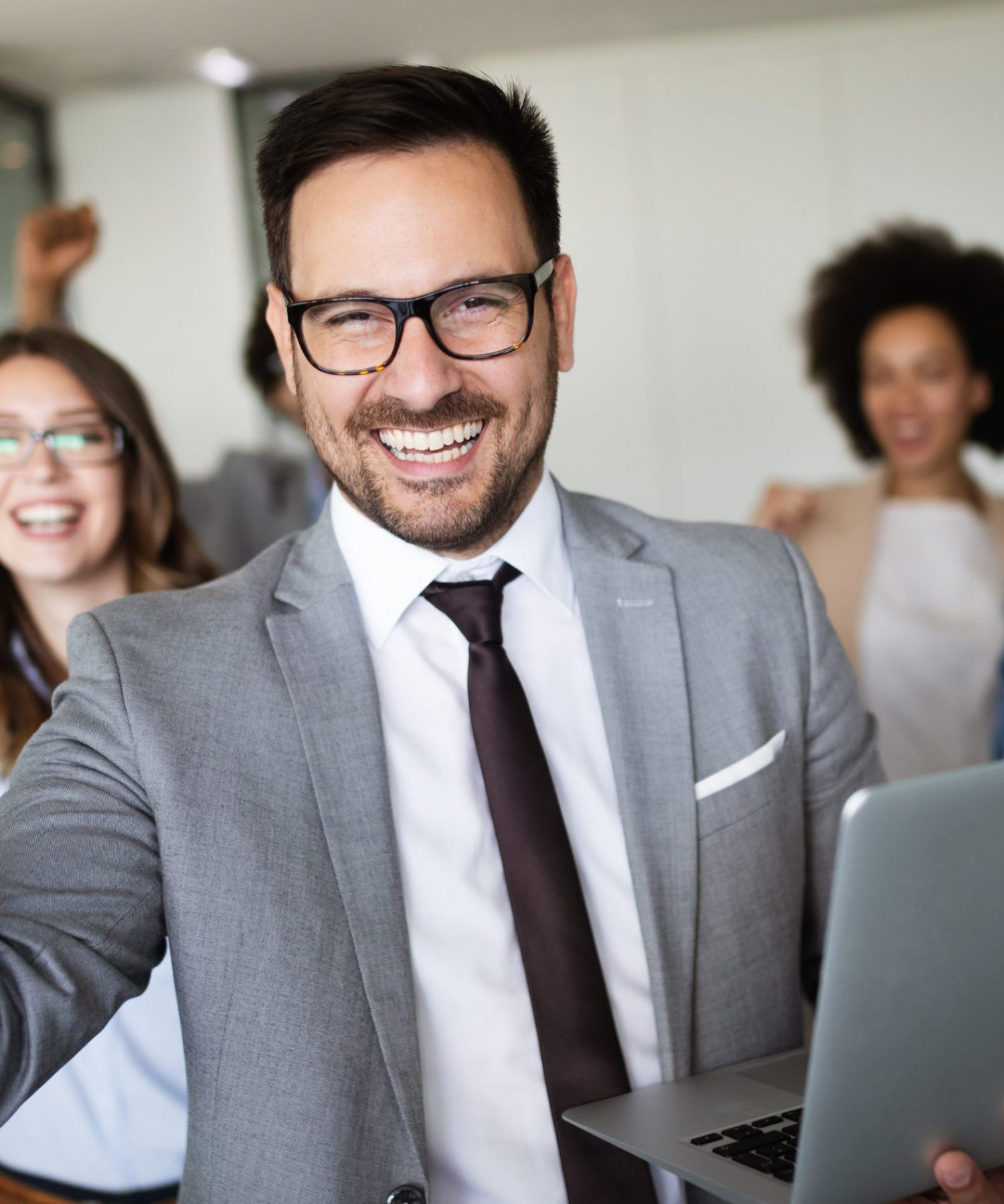 Successful company with happy workers in modern office